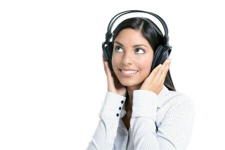 Beautiful brunette businesswoman hearing music on headphones photo