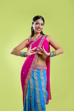 indian art: Brunette indian dancer princess Bollywood style, colorful sari