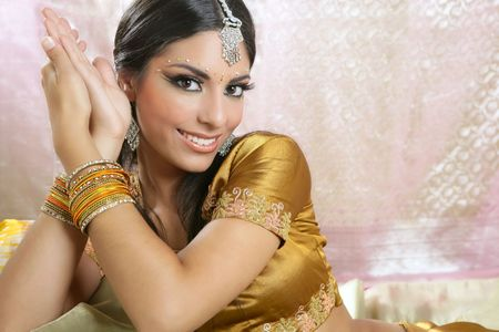 jewelery: Beautiful indian brunette portrait with traditionl costume Stock Photo