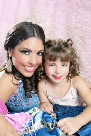 Beautiful portrait of magic indian queen and caucasian princess photo