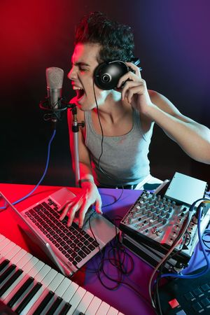 digital music: Dj with colorful light and music mixing digital equipment Stock Photo