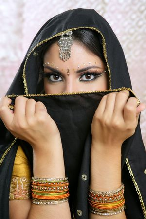 sari: Beautiful brunette asian girl with black veil on face, traditional indian costume