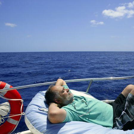 Sailor senior man having a rest on summer boat over blue ocean Stock Photo - 5544390