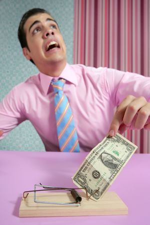 Businessman with dollar note on mouse trap over wallpaper photo