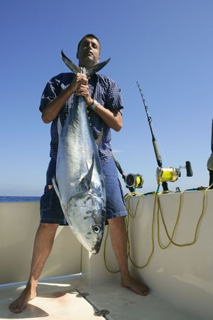 Angler fihing big game bluefin tuna on Mediterranean saltwater Stock Photo