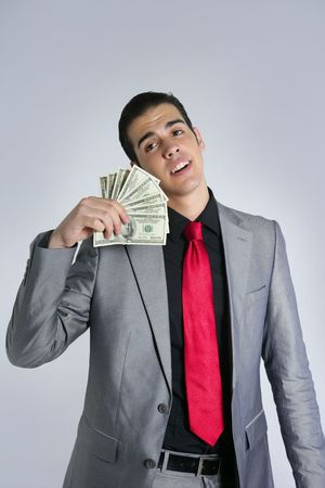 Businessman young with dollar notes suit and tie on gray background Stock Photo - 5594474