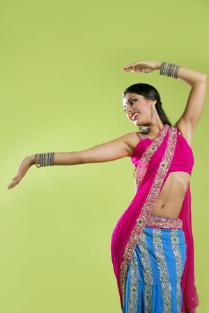 indian blue: Brunette indian dancer princess Bollywood style, colorful sari