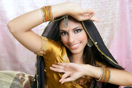 Beautiful indian brunette young woman with traditional fashion photo