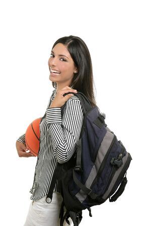 Attractive student woman with bag and basketball ball on white background photo