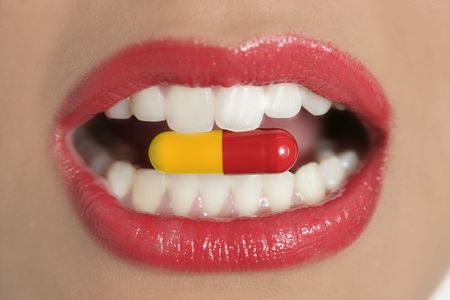 Beauty woman mouth with red lips and medicine pill photo