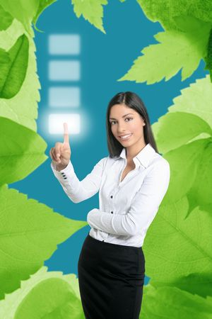 Brunette businesswoman touching virtual pad transparent key with finger Stock Photo - 5594430