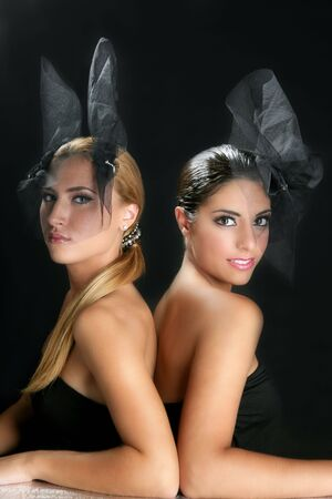 Beautiful fashion two women with veil over black Stock Photo - 5594425