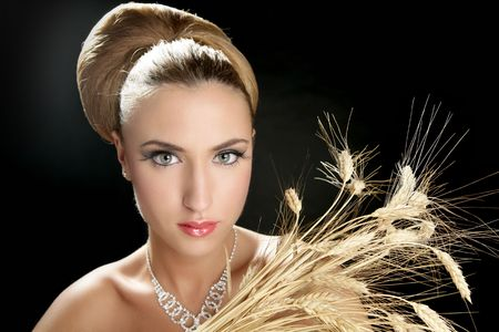 Blond fashion woman holding wheat spike over black Stock Photo - 5594439
