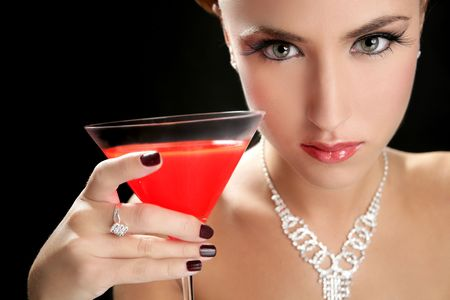 Attractive cocktail woman with jewellery and martini red glass photo