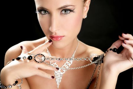 Ambition and greed in fashion woman with jewelry in hands on black background Stock Photo - 5594462