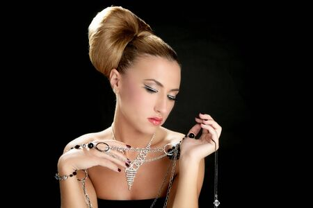 Ambition and greed in fashion woman with jewelry in hands on black background Stock Photo - 5641784