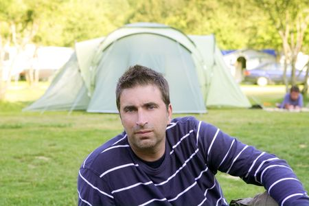 Caucassian man relaxed on the tent camping meadow  Stock Photo - 5641766