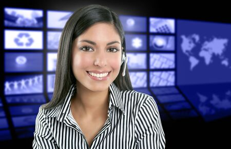Beautiful indian woman television news presenter with multiple screen background photo