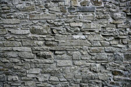 stonewall: Antique grunge old gray stone wall masonry architecture texture