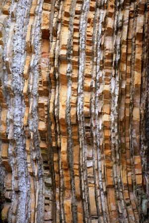stratified: Background of stone natural shapes in the coastline