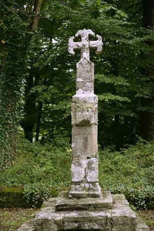 pilgrim journey: Camino de Santiago catholic pilgrin track  stone cross in Roncesvalles Stock Photo