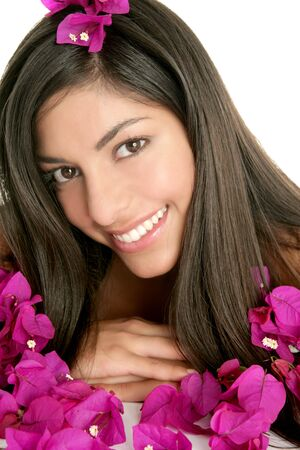 Beautiful indian woman portrait with bougainvilleas flowers over white photo