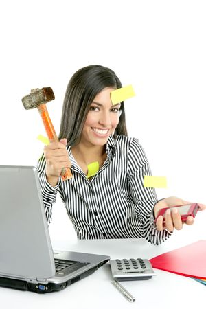 Angry brunette businesswoman with hammer against screen Stock Photo - 5675273