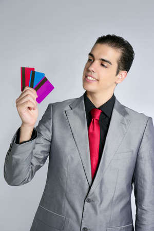 Businessman young with three credit cards in his hand photo