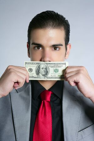 Businessman young with dollar notes suit and tie on gray background Stock Photo - 5675312