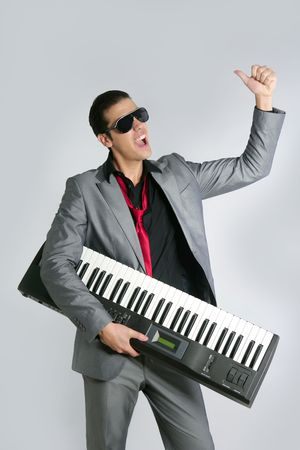 keyboard player: Businessman musician playing instrument with suit and tie