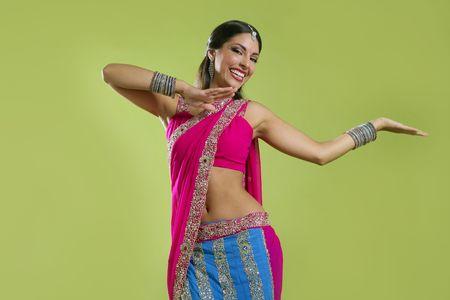 india dance: Brunette indian dancer princess Bollywood style, colorful sari
