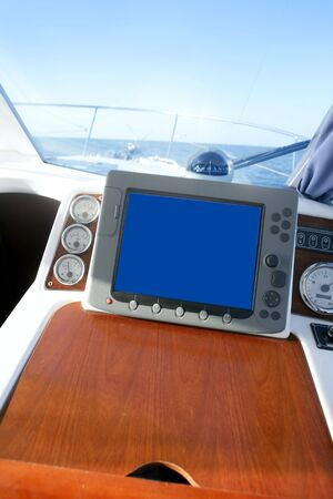 Boat indoor control bridge equipment with sea view on window photo