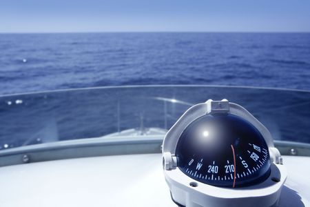 sails: Compass on a yacht boat tower on a blue summer sea ocean day
