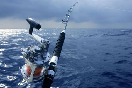 deep sea fishing: Big game obat fishing in deep sea on boat