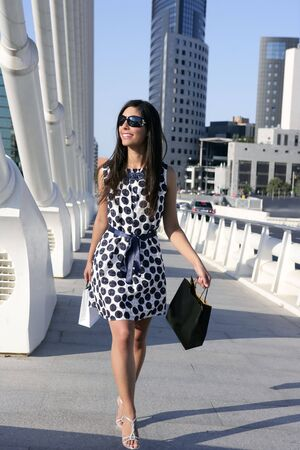 shopaholics: Beautiful brunette shopaholic outdoor modern city urban street