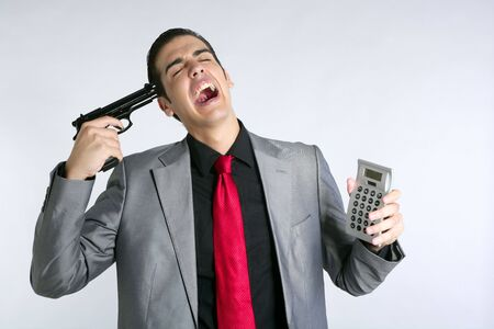 Businessman formal suit bad number news reports calculator Stock Photo - 5725192