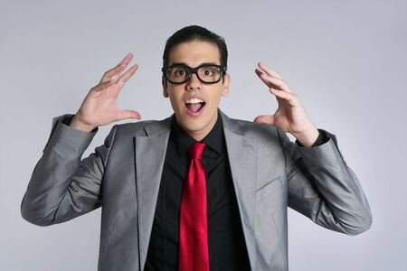 Businessman crazy with funny glasses and suit on gray background photo
