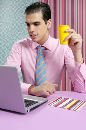 Businessman young eating fast food menu at office with laptop photo