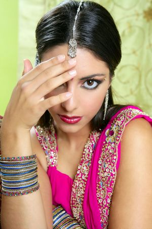 sari: Beautiful indian brunette portrait with traditionl costume Stock Photo