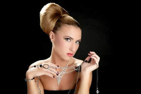 Ambition and greed in fashion woman with jewelry in hands on black background Stock Photo - 5725199