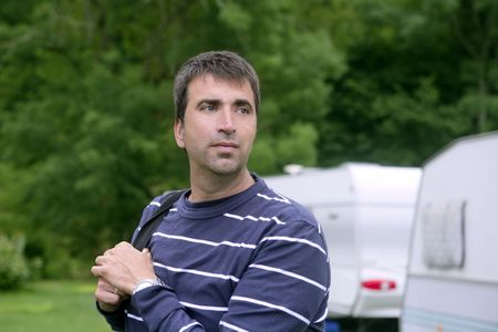 Caucasian man relaxed on the tent camping meadow Stock Photo - 5725153
