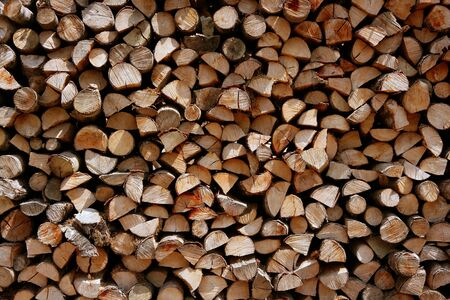 Cut firewood stack logs as pattern background photo