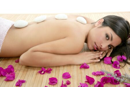 Beautiful indian woman portrait in a beauty spa with bougainvillea flowers Stock Photo