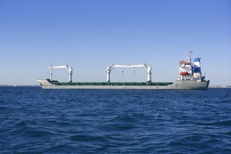 Big gray supertanker petrol oil boat transportation on a bule day photo