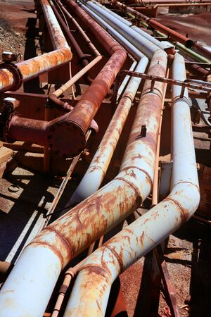 or rust: Aged rusty grunge industrial pipe lines on a mine industry