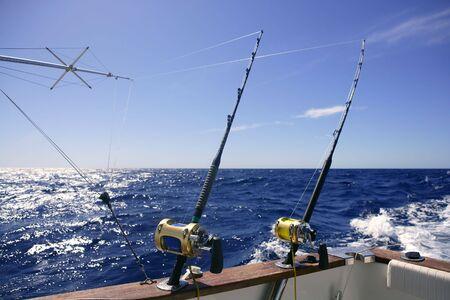 Angler boat big game fishing in saltwater ocean photo