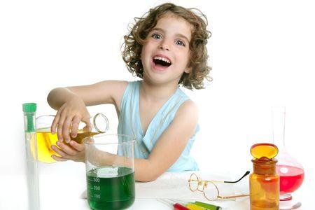 Beautiful chemistry little girl playing on a laboratory photo