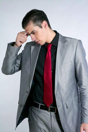 Businessman worried headache stressed and sad by work photo
