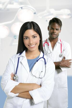 Couple of doctors asian indian woman and african man in the surgery hospital photo