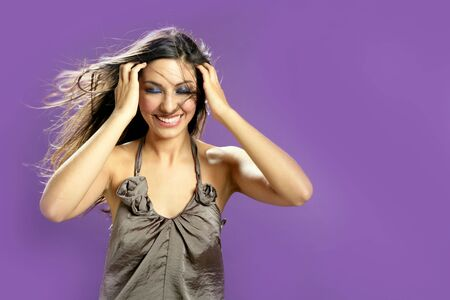 india dance: Brunette indian beautiful woman dancing at studio on purple background